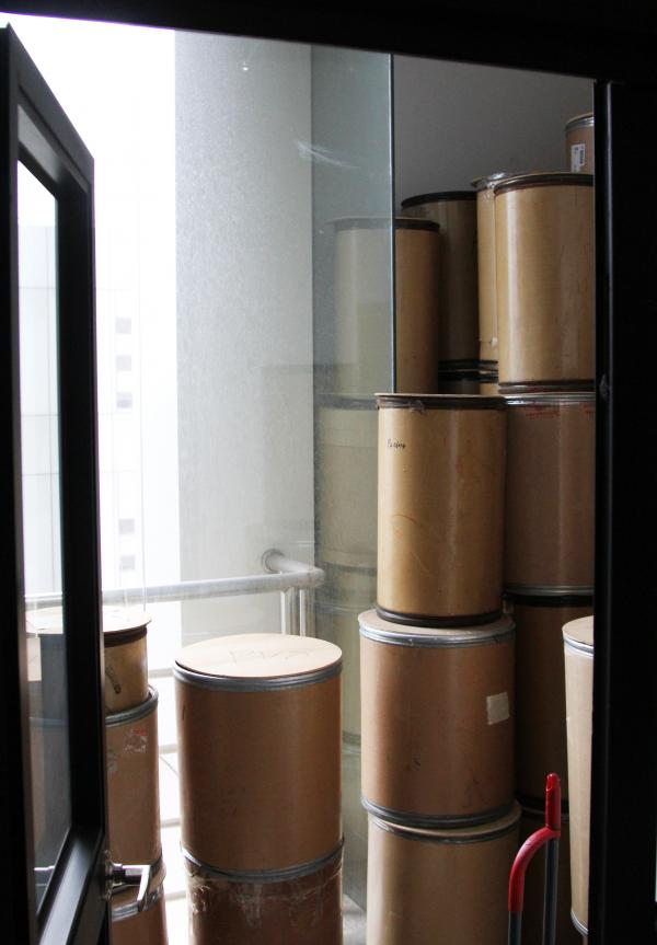 Empty chemical drums sit in a deserted lab accused of shipping illegal drugs to the U.S.