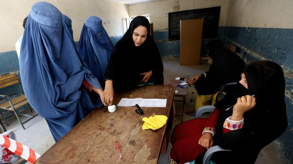 An Afghan woman inks her finger during the presidential election at a polling station in Jalalabad, east of Kabul, Afghanistan, on Saturday.