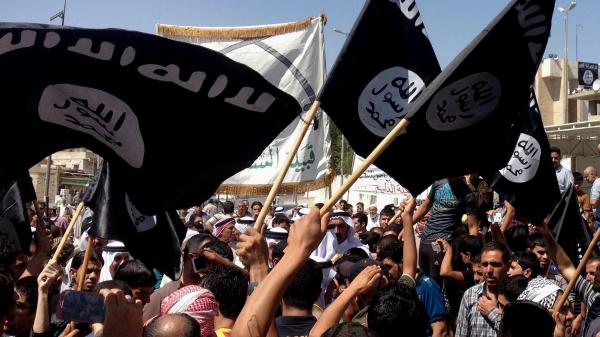 Demonstrators chant in support of the group known as the Islamic State of Iraq and Syria as they wave the group's flag in front of the provincial government headquarters in Mosul, Iraq, on Monday, after the Sunni militants captured Tal Afar, another northern Iraqi town.