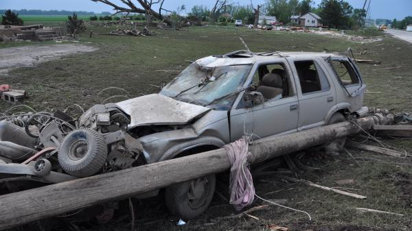 Damage is seen along Highway 15 in Pilger, Neb., Tuesday. A pair of tornadoes hit the area Monday evening.