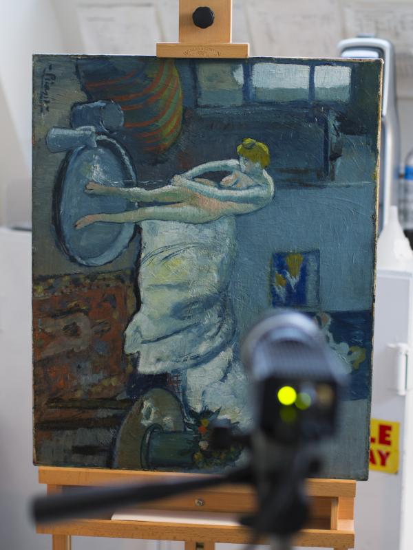 <em>The Blue Room,</em> one of Pablo Picasso's first masterpieces, sits in a vertical position in front of an infared camera at the Phillips Collection in Washington on Tuesday.