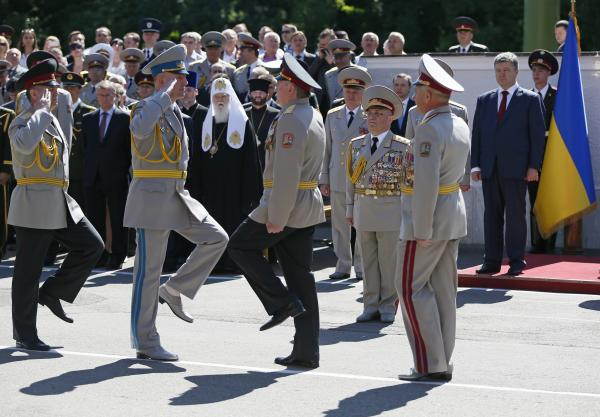 Ukrainian President Petro Poroshenko (far right) attends a graduation ceremony at the National University of Defense of Ukraine in Kiev on Wednesday. In a speech there, the president said he is ordering a cease-fire in the struggle against armed militants.