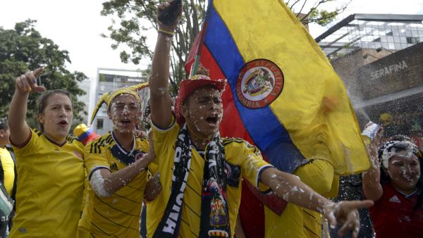 Colombian fans celebrate after their team's 3-0 victory over Greece in the opening rounds of the 2014 World Cup.