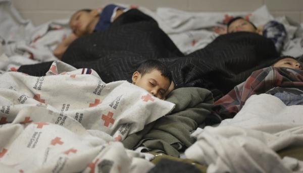 Detainees sleep in a holding cell at a U.S. Customs and Border Protection processing facility in Brownsville, Texas. This location has been central to processing the more than 47,000 unaccompanied children who have entered the country illegally since Oct. 1.  (Eric Gay/AP Photo)