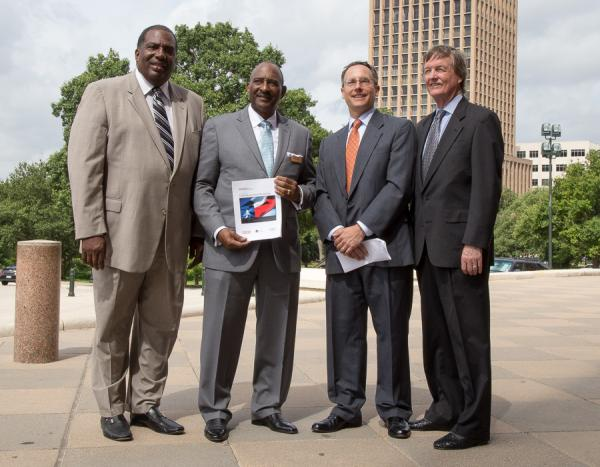 A report on the state of black-owned businesses in Texas was released today. From left: State Sen. Royce West, TAAACC Chairperson Jim Wyatt, report co-author Bruce Kellison and UT President Bill Powers.