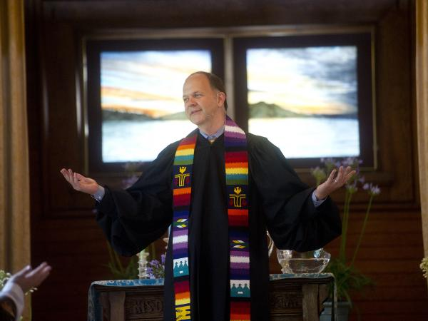 The Rev. Paul Mowry leads a Sunday service at Sausalito Presbyterian Church in Sausalito, Calif. Mowry was one of the church's first openly gay pastors.