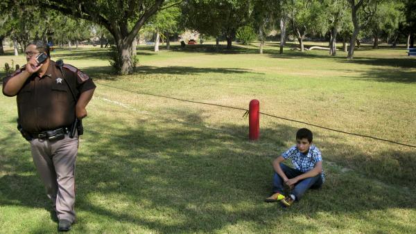 Jorge Romero, 16, a Salvadoran migrant, waits for the Border Patrol in McAllen, Texas.