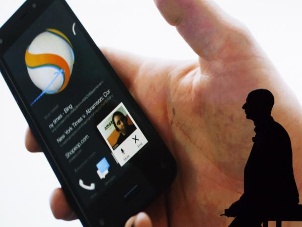 Amazon founder and CEO Jeff Bezos presents the company's first smartphone, the Fire Phone in Seattle on Wednesday.