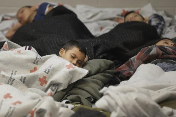 Young detainees sleep in a U.S. Customs and Border Protection holding cell in Brownsville, Texas. More than 50,000 unaccompanied migrant kids have been detained in the last eight months, an almost 100 percent increase from the previous fiscal year.