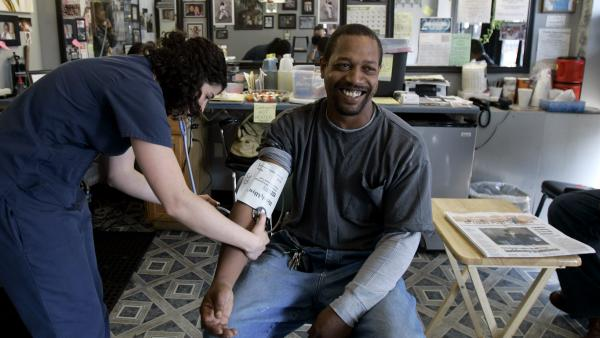 Dwight Woods has his blood pressure checked by nursing student Meghan Welsh at a St. Louis barbershop in 2009. A new study in LA will train barbers to take clients' blood pressure themselves in order to address the problem of hypertension among African-American men.