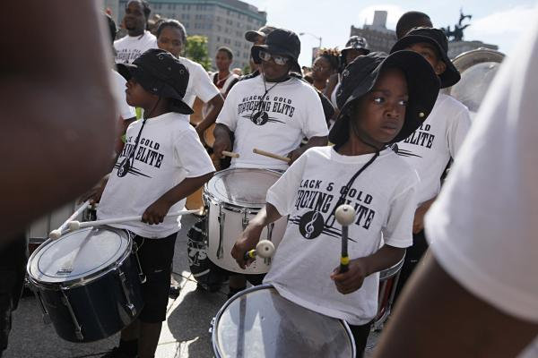 Members of The Black and Gold Marching Elite, an after-school program that serves students from across New York City, also participate.