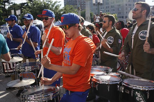 The drum lines for the New York Knicks, the New York Jets and the New York Giants join in the fun.