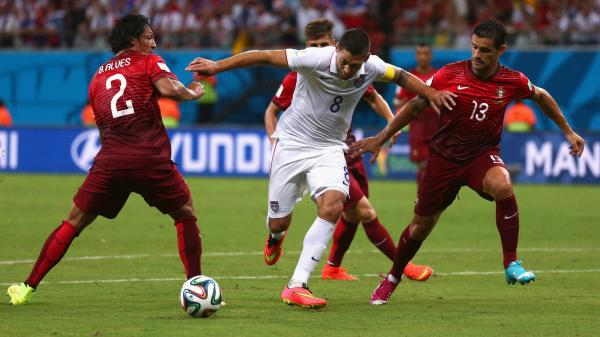 Clint Dempsey of the United States is challenged by Portugal's Bruno Alves (left) and Ricardo Costa during the 2014 FIFA World Cup Group G match Sunday in Brazil.