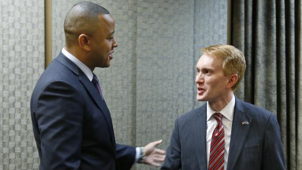 State Rep. T.W. Shannon (left) talks with U.S. Rep. James Lankford following a June 6 Republican candidate forum for the open U.S. Senate seat in Lawton, Okla.