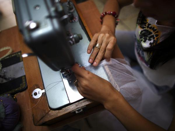 Franco says business was booming when she was able to import clothing from countries like Brazil and the U.S. Once the government cracked down on imports, she learned to sew.