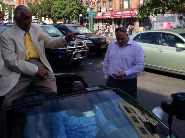 Rangel leaves a Harlem campaign event in a silver Corvette convertible.