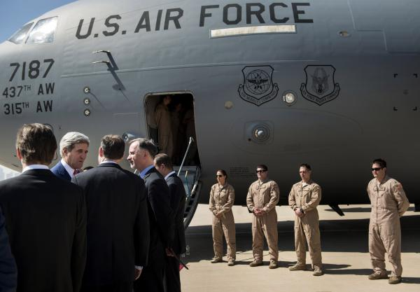 "Secretary of State John Kerry (second from left) arrives at Irbil International Airport with U.S. Ambassador to Iraq Robert Stephen Beecroft (fourth from left) on Tuesday. The president of Iraq's ethnic Kurdish region declared Tuesday that ""we are facing a new reality and a new Iraq."""