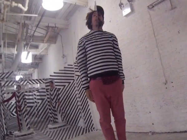 "A behind-the-scenes look at OK Go making their video ""The Writing's on the Wall."""