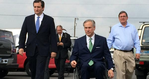 U.S. Sen. Ted Cruz and Texas Attorney General Greg Abbott (foreground, L, R) were joined by U.S. Rep. Michael Burgess, R-Flower Mound, (background, R) in touring Joint Base Lackland San Antonio today.