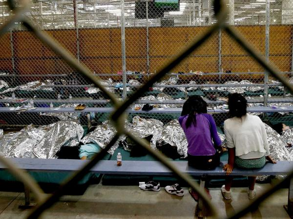 Two young girls at a U.S. Customs and Border Protection center in Nogales, Ariz.