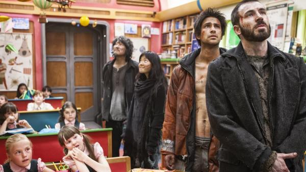 In <em>Snowpiercer</em>, the children of the wealthy who inhabit the front of the train are offered luxuries such as education, while the people who dwell in the train's rear — (from right) Curtis (Chris Evans), Grey (Luke Pasqualino), Yona (Ah-sung Ko) and Namgoong Minsoo (Song Kang-ho) — survive in squalor.