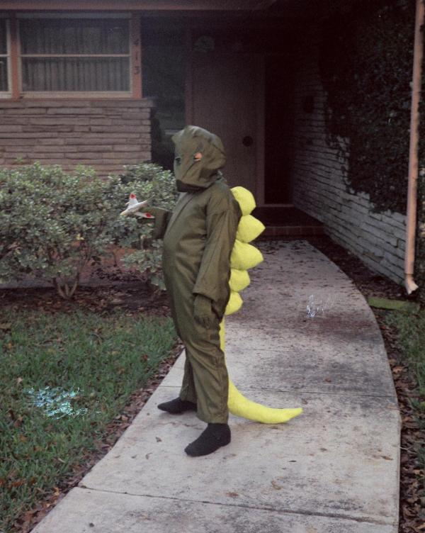 William Tsutsui in 1972 at age 9, in a Godzilla suit made by his mother for Halloween.