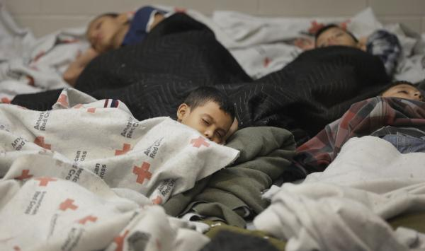 Children detainees sleep in a holding cell at a U.S. Customs and Border Protection processing facility in Brownsville,Texas.