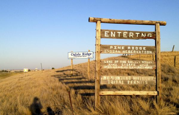 "Signs marking the entrance to the Pine Ridge Indian Reservation in South Dakota make it clear when you're literally ""off the reservation,"" but the figurative meaning of the phrase has shifted over time."