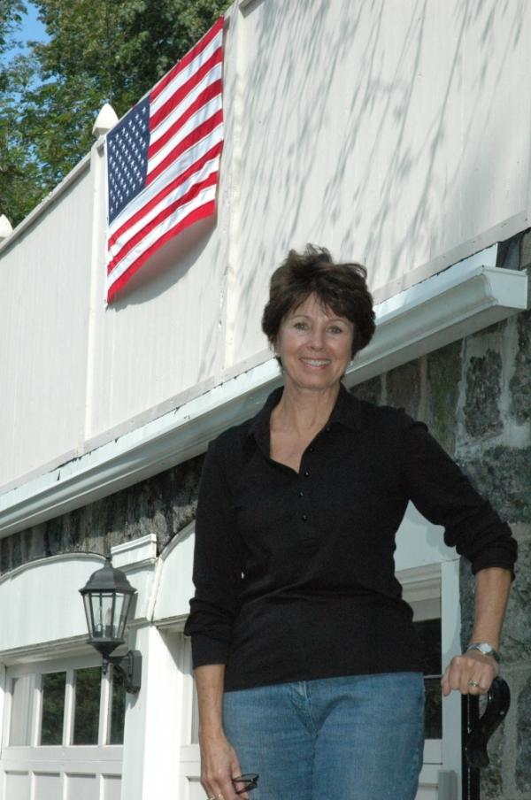 Brookline parent Sandra Maloney is calling on other residents to hang flags outside to show  support for keeping the Pledge of Allegiance in public school classrooms.