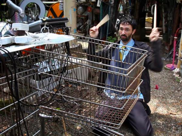 Filastine performs a song on shopping carts at The Cathedral of Junk in Austin, Texas.