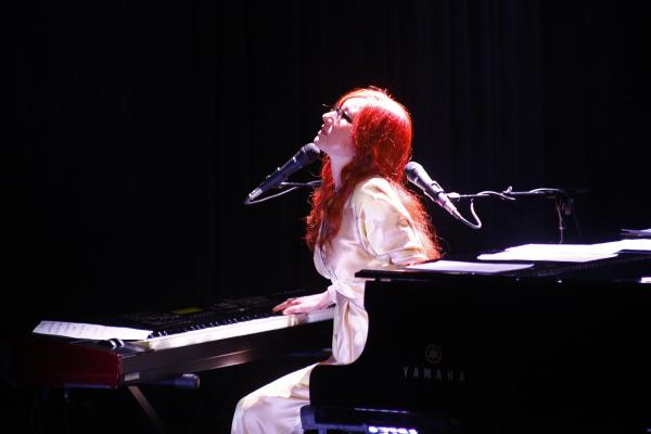 """In an interview with NPR Music critic Ann Powers before the show, Amos said that her favorite lyric to sing after twenty years is """"When you gonna make up your mind / When you gonna love you as much as I do"""" from """"Winter."""" She ended the evening with that song."""