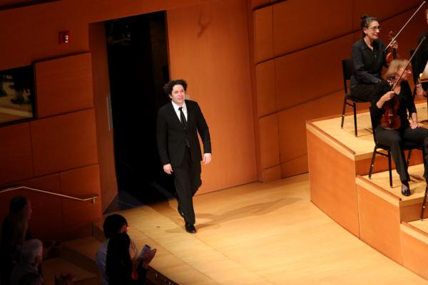 Dudamel comes back onstage to receive the audience's cheers at the end of <em>The Rite of</em> <em>Spring</em>.