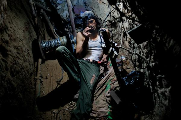 This Gazan university student works in a tunnel, hauling goods to earn money for tuition. Many workers put in 12-hour shifts six days a week — or more — in the cramped spaces. Gas explosions, electrocutions and Israeli airstrikes are common.