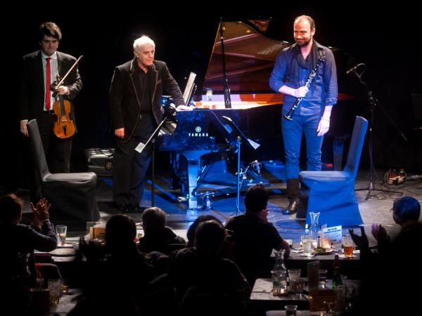 Conductor and pianist Daniel Barenboim (center) brought members of his West-Eastern Divan Orchestra (including his son Michael Barenboim, left, and Kinan Azmeh) to the intimate spaces of Manhattan's Le Poisson Rouge.