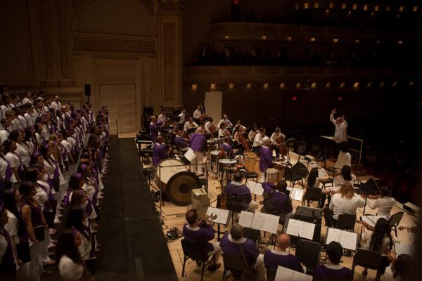 Conductor Robert Spano led a cast of some 195 musicians, including several choirs. Golijov's updated <em>Passion</em>, from 2000, seamlessly combines elements of western choral music, western orchestral instruments and deep folkloric Latin American rhythms, instruments and dances.