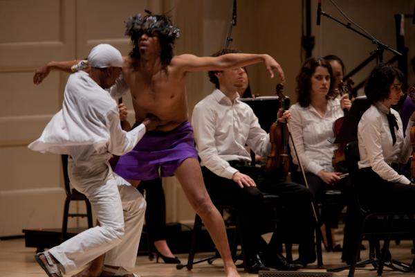 Deraldo Ferreira, left, pierces Jesus, played by Afro-Cuban singer and dancer Reynaldo Gonzalez-Fernandez.