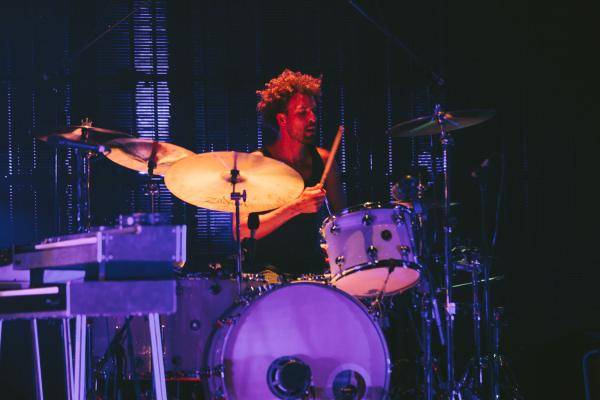 Dave Grohl is one of three drummers on record, but touring drummer Jon Theodore from Mars Volta joined QOTSA for this show.