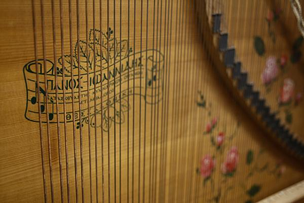 Part of the interior of Giannikou's <em>laterna</em> — an old Greek instrument that had faded out of use by World War II. It's something akin to an upright player piano, with thousands of little nails pinned into a small cylinder in its base. Each nail activates the strike of a string, creating one played note.