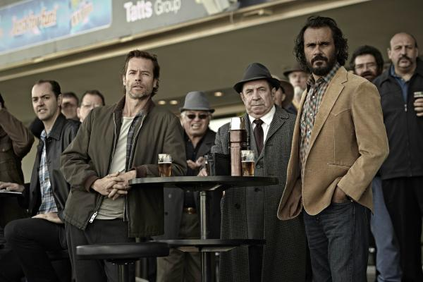 Guy Pearce (front left) plays Jack Irish in TV movie adaptations of two Peter Temple novels. The films, <em>Bad Debts </em>and <em>Black Tide</em>, are broadcast by digital provider Acorn TV.