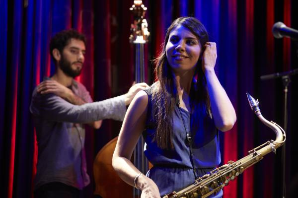 Melissa Aldana performs with her Crash Trio, including bassist Pablo Menares.