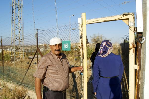 At first, Ishaq's family had to wait for Israeli soldiers to open this gate and let them come or go. Now, the family has a key.