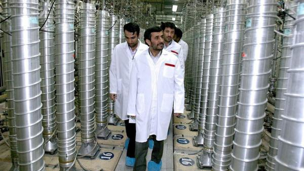 Former Iranian President Mahmoud Ahmadinejad inspects the Natanz nuclear plant in central Iran on March 8, 2007. The tall cylinders are centrifuges for enriching uranium.