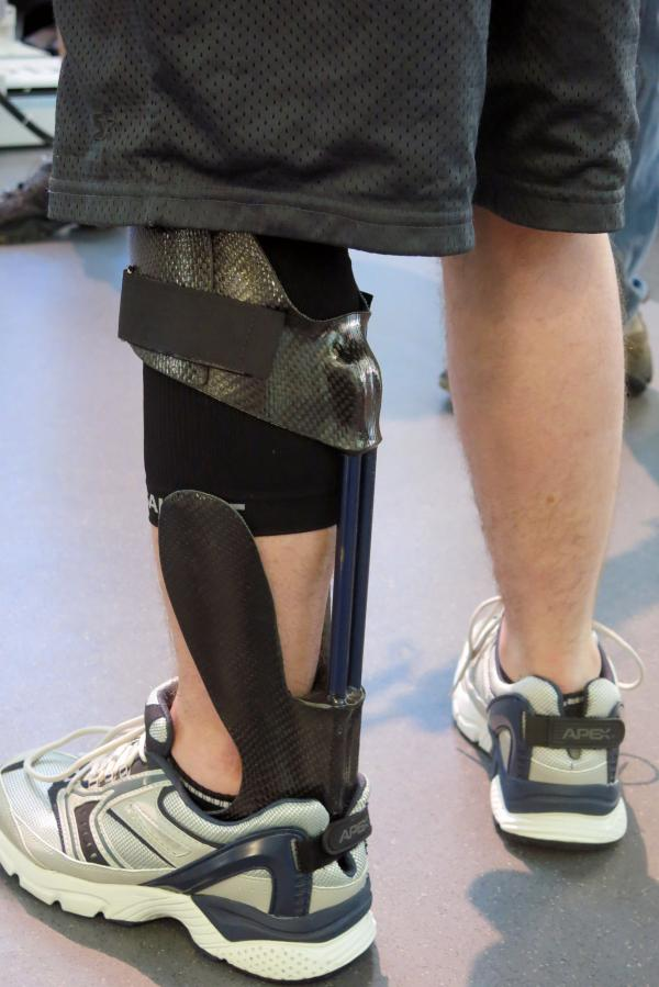 The IDEO brace helps transfer energy so the wearer can step forward.