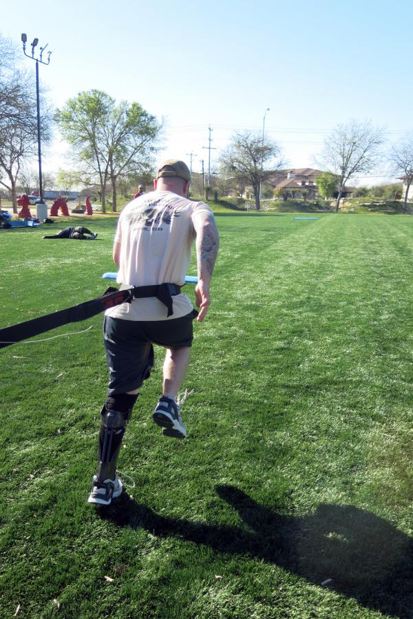 "Army Spc. Joey McElroy practices resistance running with the IDEO. Soldiers who are fitted with the brace spend four weeks learning how to use it in a ""Return to Run"" program."