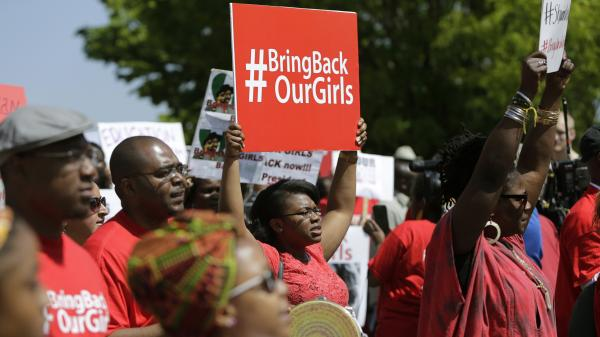 Protesters march in front of the Nigerian Embassy in Washington, D.C., on Tuesday in support of the girls kidnapped by members of the Islamist group Boko Haram.
