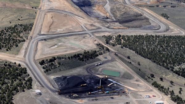 Some universities have stopped investing in coal companies, but many others don't see the point. An aerial view of the Coal Hollow Mine in Utah in 2012.