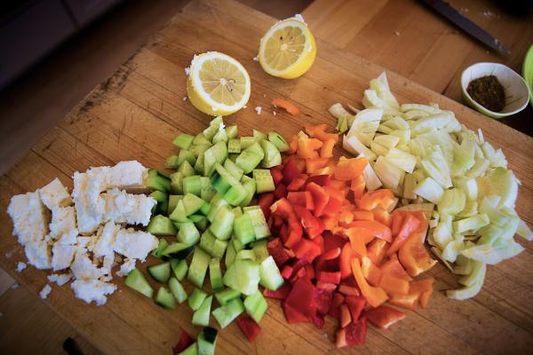Chopped feta cheese, cucumber, bell peppers and fennel and halved a lemon and a small bowl of za'tar. (Jesse Costa/WBUR)
