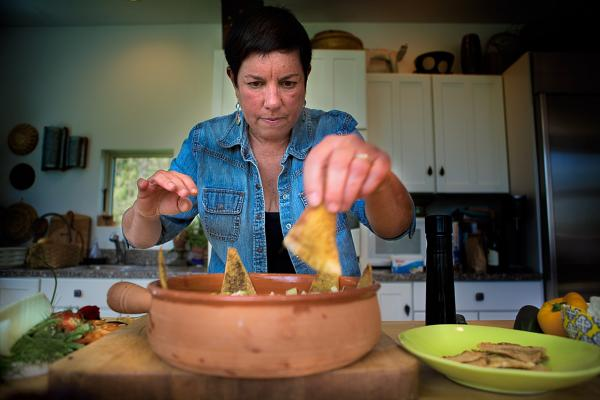 Placing the za'tar seasoned pita chips around the bowl. (Jesse Costa/WBUR)