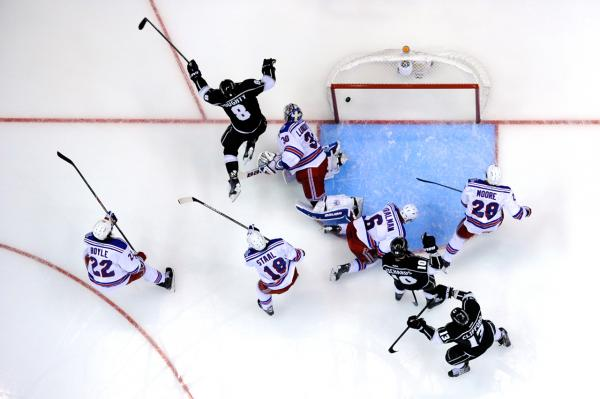 Drew Doughty, #8, of the Los Angeles Kings, celebrates after he scores a second period goal past Henrik Lundqvist, #30, of the New York Rangers, during Game One of the 2014 NHL Stanley Cup Final at the Staples Center on June 4 in Los Angeles. (Kevork Djansezian/Getty Images)