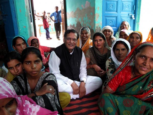 Humanitarian Bindeshwar Pathak sits surrounded by women from the village of Hir Mathala in the northern Indian state of Haryana. Pathak built low-maintenance, low-cost toilets in the village and wants to do the same in other villages.